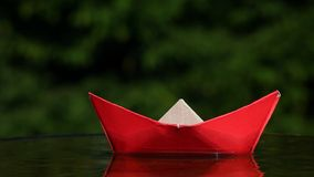 Red paper boat autumn garden footage hd. Day light stock video footage
