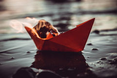 Red paper boat on fire royalty free stock image