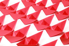 Red paper boats. Several red paper boats on white background stock image