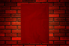 Red paper on brick wall Stock Image