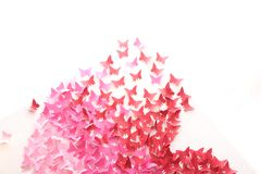 Red paper butterfly on white paper. royalty free stock photo