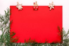 Red paper card on a christmas clothes peg. On a white background stock images