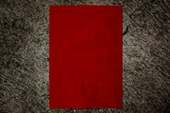 Red paper on cement wall Stock Photography
