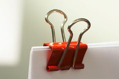 Red Paper Clip or Binder Clip Royalty Free Stock Image