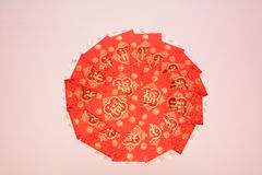 Red paper containing money as a gift Royalty Free Stock Photos