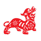Red paper cut a Chinese dog zodiac and flower symbols Stock Image