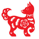 Red paper cut a dog zodiac and flower symbols Stock Image