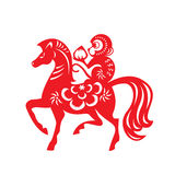 Red paper cut monkey and horse zodiac symbol (monkey holding peach on horseback) Royalty Free Stock Images