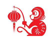 Red paper cut monkey zodiac symbol (monkey holding lantern) Royalty Free Stock Photo