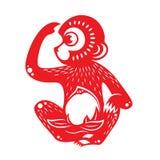 Red paper cut monkey zodiac symbol (monkey holding peach) Royalty Free Stock Image