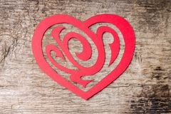 Red Paper Cut out Heart with ornament on wood Stock Photography