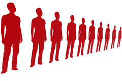 Red paper cutouts standing Stock Photo