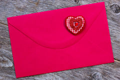 Red paper envelope with decorative heart Stock Image