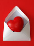 Red paper envelope with heart. Isolated on white background Royalty Free Stock Image