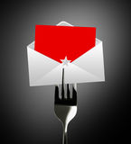 Red paper envelope letter on fork Stock Images