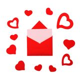 Red paper envelope with pink card and hearts Stock Photos