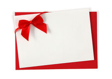 Red paper envelope with white card. Isolated on white background Stock Image