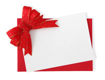 Red paper envelope with white card. Isolated on white background Royalty Free Stock Photography