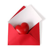 Red paper envelope with white card. And heart isolated on white background Stock Photography