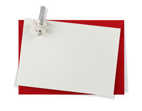 Red paper envelope with white card. Isolated on white background Stock Photos