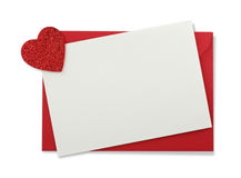 Red paper envelope with white card and heart. Isolated on white background Royalty Free Stock Images