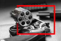 Red paper frame with .357 Caliber Revolver Pistol royalty free stock image