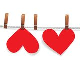 Red paper heart attached to a clothesline with pin Stock Images