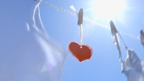 Red Paper Heart on a Clothesline - symbol for love stock video footage