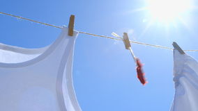 Red Paper Heart on a Clothesline - symbol for love stock footage