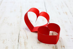 Red paper heart copy space on white wood Stock Photography