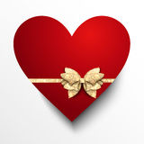 Red paper heart with gold bow Stock Photos