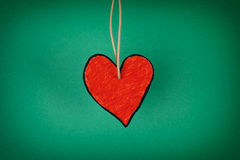 Red paper heart on a green background Royalty Free Stock Photography