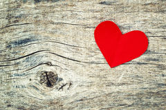 Red paper heart on grunge wooden background Royalty Free Stock Photography