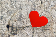 Red paper heart on grunge wooden background Stock Image