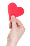Red  paper heart in hand Stock Images