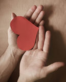 Red paper heart in hands. Card for a loved one Stock Images