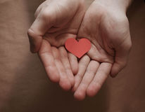Red paper heart in hands. Card for a loved one Stock Photography