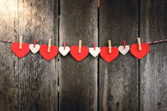 Red paper heart hanging on the clothesline Stock Images