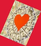 Red paper heart and hundred dollar bills. On red Stock Images