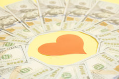 Red paper heart and hundred dollar bills. For background Stock Photos