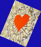 Red paper heart and hundred dollar bills. On blue Stock Photography