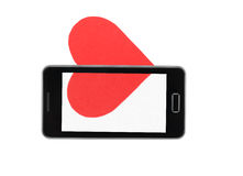 Red paper heart in the mobile phone, concept relationships Stock Image