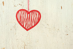 Red   paper heart  on a  old  white wood. Red openwork  paper heart  on a  old  white wood Stock Photo