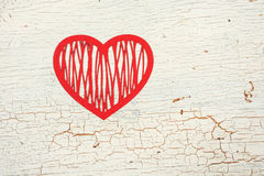 Red paper heart. On an old wooden door Royalty Free Stock Images