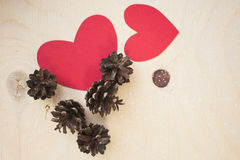 Red paper heart and pine cones Royalty Free Stock Photo