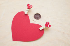 Red paper heart with pins Royalty Free Stock Photography