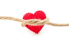 Red paper heart with rope. Stock Image