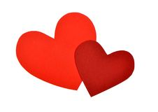 Red paper heart shape. Two cut out of paper heart shape royalty free stock image