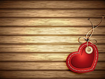 Red Paper Heart Shaped Tag on Wooden Background. Vector illustration representing red paper heart shaped tag with ribbon on wooden background stuck with nail Royalty Free Stock Photo