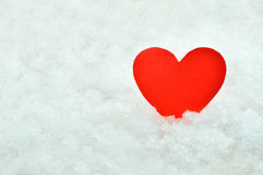 Red paper heart on snow background Royalty Free Stock Images
